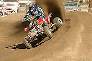 Harold Goodman (#708) powerslide a high banked berm during the ATVA Nationals Round #1 at Glen Helen.