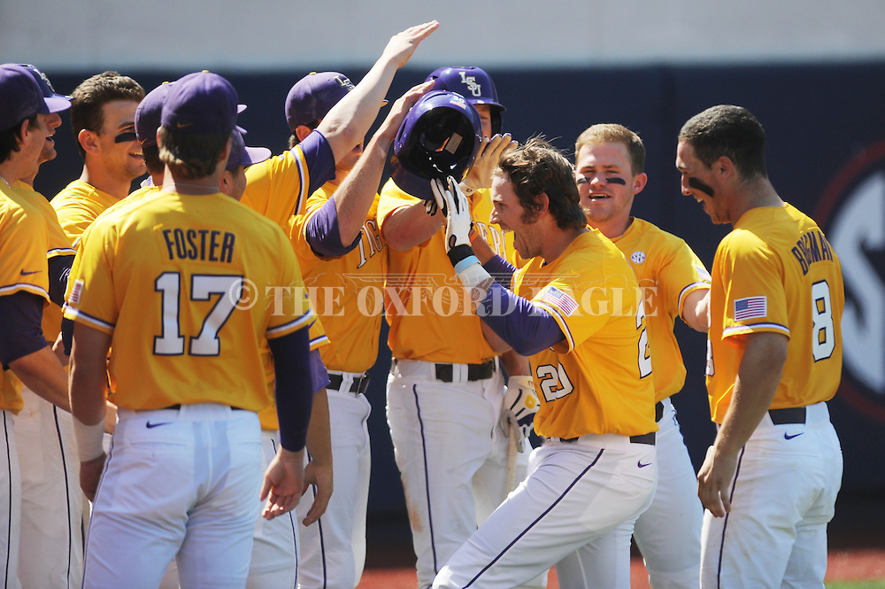 LSU's Conner Hale (20) is congratulated by teammates following his 8th inning solo home run against Mississippi at Oxford-University Stadium in Oxford, Miss. on Saturday, April 19, 2014. (AP Photo/Oxford Eagle, Bruce Newman)