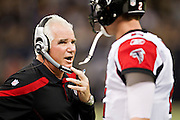 NEW ORLEANS, LA - DECEMBER 26:   Head Coach Mike Smith talks with Quarterback Matt Ryan #2 of the Atlanta Falcons during a game against the New Orleans Saints at Mercedes-Benz Superdome on December 26, 2011 in New Orleans, Louisiana.  The Saints defeated the Falcons 45-16.  (Photo by Wesley Hitt/Getty Images) *** Local Caption *** Mike Smith; Matt Ryan