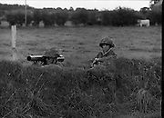 "Army Exercises In Co Sligo.   (L37).<br /> 1977.<br /> 05.09.1977.<br /> 09.05.1977.<br /> 5th September 1977.<br /> The Army Reserve Brigade, which is made up of regular units from the Southern Command, are conducting a series of conventional military exercises in counties Mayo and Sligo from the 5th to the 9th September. Approximately 1,500 men and 250 vehicles are involved. The exercise was codenamed ""Humbert"" after an ill fated expedition by French troops into Ireland on 23rd August 1798. 1,100 French troops with Irish support took on the incumbent English forces. After some initial success they were defeated at Ballinamuk on 8th Sept 1798 by the army of Cornwallis.<br /> Picture shows some soldiers taking up position during the military exercises."
