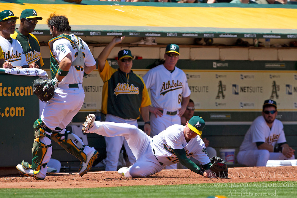 OAKLAND, CA - MAY 19: Josh Donaldson #20 of the Oakland Athletics catches a foul ball hit off the bat of David Lough #7 of the Kansas City Royals (not pictured) of the Kansas City Royals during the fourth inning at O.co Coliseum on May 19, 2013 in Oakland, California. (Photo by Jason O. Watson/Getty Images) *** Local Caption *** Josh Donaldson