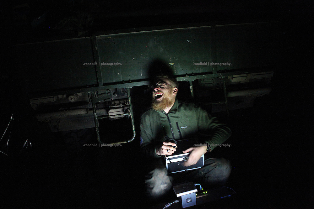A private laughs at night sitting in front of a armored Dingo. In late October 2011 Kunduz based 3.Task Force started a several days operation in and around Nawabad (District Chahar Darah), west of Kunduz, northern Afghanistan. During the Operation Orpheus about 100 german infantery soldiers rolled out for patrols through the town and surrounding areas, which were expected as a retreat zone of insurgents.