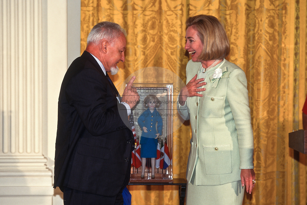 Hillary Clinton with Jordan Pokrinchak as he gifts her a Hillary Doll during the second White House gathering of the Hillary Clinton Fan in the East Room in Washington, DC.
