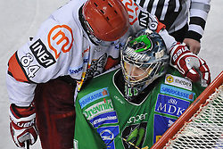Andrej Hebar of Acroni Jesenice and Goalkeeper of Olimpija Ales Sila at 6th Round of ice-hockey Slovenian National Championships match between HDD Tilia Olimpija and HK Acroni Jesenice, on April 2, 2010, Hala Tivoli, Ljubljana, Slovenia.  Acroni Jesenice won 3:2 after overtime and became Slovenian National Champion 2010. (Photo by Matic Klansek Velej / Sportida)