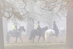 © Licensed to London News Pictures. 05/02/2020. London, UK. Horse riders enjoy the dense fog in Richmond Park. A foggy start for cyclists and drivers this morning in Richmond Park as weather experts predict more fog followed by high winds and heavy rain for the weekend. Photo credit: Alex Lentati/LNP