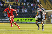 Notts County midfielder Alan Smith controls the ball while York City forward Emile Sinclair watches on  during the Sky Bet League 2 match between Notts County and York City at Meadow Lane, Nottingham, England on 26 September 2015. Photo by Simon Davies.