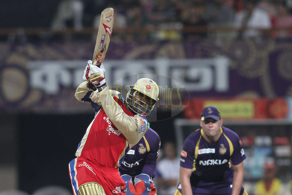 Chris Gayle of the Royal Challengers Bangalore attacks a delivery during match 38 of the the Indian Premier League (IPL) 2012  between The Kolkata Knight Riders and The Royal Challengers Bangalore held at the Eden Gardens Stadium in Kolkata on the 28th April 2012..Photo by Shaun Roy/IPL/SPORTZPICS