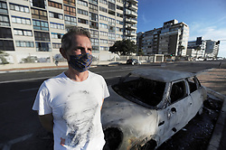 South Africa - Cape Town - 6 May 2020 - A Sea Point Good Samaritan who ignored opposition from some residents to feed homeless people during the national lockdown was stunned after his car was set alight in the early hours of Wednesday morning. Peter Wagenaar believes the torching of his Mini Cooper was an escalation of the backlash he had been receiving from the community.. Photographer: Armand Hough/African News Agency(ANA)