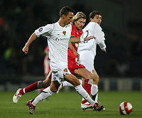Photo: Paul Thomas.<br /> Blackburn Rovers v Basle. UEFA Cup. 02/11/2006.<br /> <br /> Reto Zanni (L) of Basel tries to out run Robbie Savage (Red).