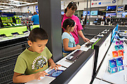 ROGERS, AR - OCTOBER 12:  Marlana Norton looks at laptop computers in the Entertainment Department with her son Gabriel and daughter Liberty at Walmart Store #4208 on October 12, 2015 in Rogers, Arkansas.  <br /> CREDIT Wesley Hitt for Wall Street Journal<br /> WALSQUEEZE