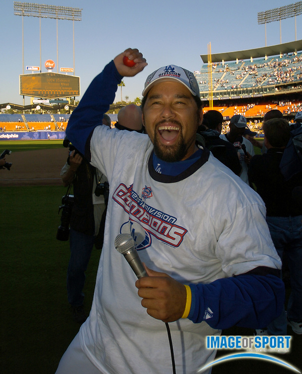 Oct. 2, 2004; Los Angeles, CA, USA; Los Angeles Dodgers pitcher Jose Lima (27) celebrates after 7-3 victory over the San Francisco Giants to clinch the National League West Division title at Dodger Stadium.
