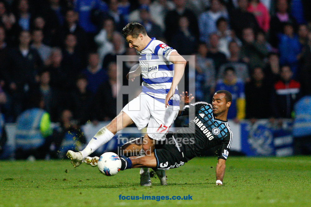 Picture by Andrew Tobin/Focus Images Ltd. 07710 761829. 23/10/11. Ashley Cole (3) of Chelsea tackes Joey Barton (17) of QPR during the Barclays Premier League match between QPR and Chelsea at Loftus Road, London.
