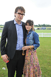 MARTHA FREUD and ADAM SMITH at the 2011 Veuve Clicquot Gold Cup Final at Cowdray Park, Midhurst, West Sussex on 17th July 2011.