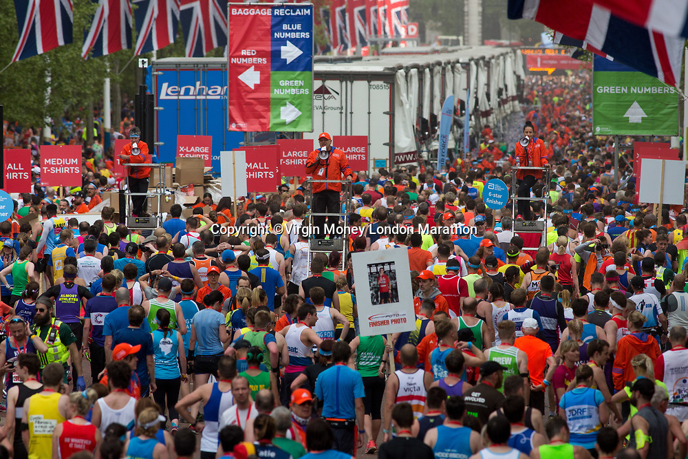 Runners funnel towards Admiralty Arch as they cross the finish line. The Virgin Money London Marathon, 23rd April 2017.<br /> <br /> Photo: Roger Allen for Virgin Money London Marathon<br /> <br /> For further information: media@londonmarathonevents.co.uk