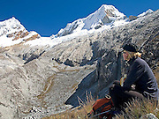 Lorna Backhouse views the summits of Huandoy Este (East) 6,068m and Pisco Oeste (West) 5,752m from the trail between Pisco Base Camp and Laguna 69, at approx. 5,000m.