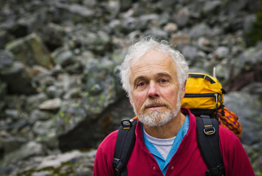 Portrait of a mature male mountain climber at on a talus slope, near Snoqualmie Pass, Washington, USA.