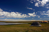 Yurt Camp and pond on the Great Plains of Montana at American Prairie Reserve. South of Malta in Phillips County, Montana.