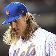 NEW YORK, NEW YORK - October 5: Pitcher Noah Syndergaard #34 of the New York Mets after getting three outs in the second inning during the San Francisco Giants Vs New York Mets National League Wild Card game at Citi Field on October 5, 2016 in New York City. (Photo by Tim Clayton/Corbis via Getty Images)
