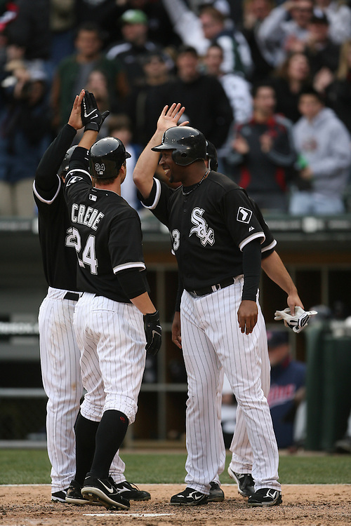 CHICAGO - APRIL 7:  Jermaine Dye #23 of the Chicago White Sox and other teammates greet Joe Crede #24 after Crede hit a grand slam home run in the 7th inning off  of Pat Neshek during the game against the Minnesota Twins at U.S. Cellular Field in Chicago, Illinois on April 7, 2008.  The White Sox defeated the Twins 7-4.  (Photo by Ron Vesely)