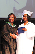 Principal Marlayna A. Randolph (left) with graduate Aniqua Roebuck during the Paul Laurence Dunbar High School commencement in the Dayton Convention Center in downtown Dayton, Wednesday, May 23, 2012.