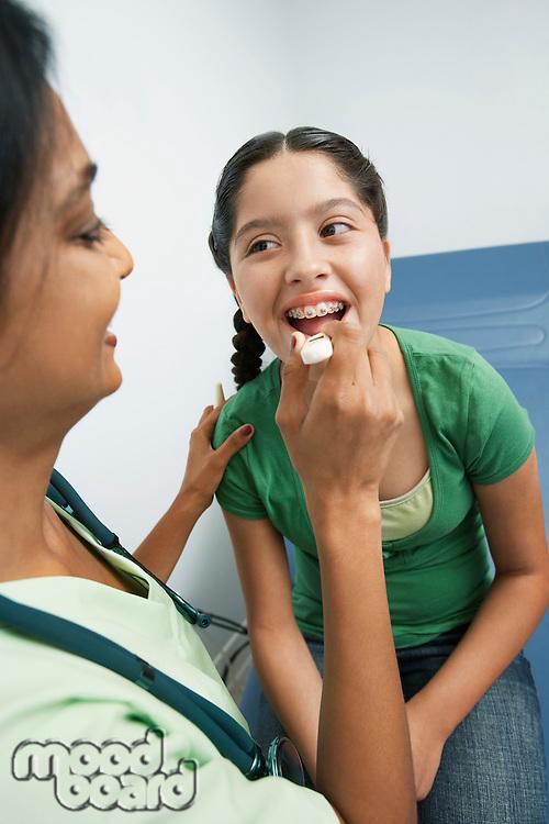 Female doctor examining girl