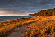 Golden sunlight covers the Lake Michigan shore at Esch Road Beach.  Sleeping Bear Dunes National Lakeshore