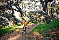Model rides bike through canyon