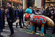City businessmen drink in Leadenhall Market in the City of London, on England's national St George's Day the 23rd April,