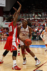 March 21, 2011; Stanford, CA, USA; Stanford Cardinal forward Nnemkadi Ogwumike (30) is defended by St. John's Red Storm forward Centhya Hart (30) during the second half of the second round of the 2011 NCAA women's basketball tournament at Maples Pavilion. Stanford defeated St. John's 75-49.