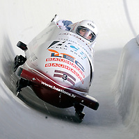 01 March 2009:    The Latvia 1 bobsled driven by Janis Minins with sidepushers Daumants Dreiskens and Oskars Melbardis, and brakeman Intars Dambis drives through turn 19 in the 3rd run at the 4-Man World Championships competition on March 1 at the Olympic Sports Complex in Lake Placid, NY.   The USA 1 bobsled driven by Steven Holcomb with sidepushers Justin Olsen and Steve Mesler, and brakeman Curtis Tomasevicz won the competition and the World Championship bringing the U.S. their first world championship since 1959 with a time of 3:36.61.   The Latvian team finished in 3rd place, bringing Latvia their first World Cup medal in history.
