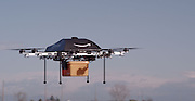 Amazon announces delivery by DRONE: Online retailer claims airborne robots will bring packages to your door in 30 minutes <br /> <br /> Amazon has unveiled its secret research project which it claims will be the future of home delivery - packages delivered by drones.<br /> <br /> The Internet shopping giant's chief executive Jeff Bezos says that he wants to use octocoptors to replace postmen and cut delivery times to just 30 minutes.<br /> <br /> Customers would have their order dropped onto their front lawn by the machine which would fly through the air from a nearby warehouse with it clasped in a metal grabber.<br /> <br /> It is not clear if the drones are a PR stunt or a serious proposition, but speaking to US TV network CBS, Bezos said: 'I know this looks like science fiction. It's not.'<br /> <br /> Bezos' claims raise the prospect of a future where drones whiz across the sky all the time ferrying post around - and perhaps one day even letters too. <br /> <br /> In the interview Bezos said that the drones would be able to carry goods up to five pounds in weight, which covers 86 per cent of the items that the company delivers.<br /> <br /> Bezos said that he wants to launch the 'Amazon Prime Air' service within four to five years, though that will almost certainly be in the US before anywhere else.<br /> <br /> He said: 'These generations of vehicles, it could be a ten-mile radius from a fulfillment (delivery) center.<br /> <br /> 'So, in urban areas, you could actually cover very significant portions of the population.<br /> <br /> 'And so, it won't work for everything; you know, we're not gonna deliver kayaks or table saws this way. These are electric motors, so this is all electric; it's very green, it's better than driving trucks around. This is all an R&D project'.<br /> <br /> Bezos said that the octocoptors would be autonomous so would not need a pilot to guide them.<br /> <br /> Instead they would use GPS tracking to find their way to and from the address.<br /> <br /> Bezos said: The hard part here is putting in all the redundancy, all the reliability, all the systems you nee