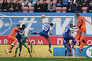 Wigan's Kal Naismith heads the ball during the EFL Sky Bet Championship match between Wigan Athletic and Ipswich Town at the DW Stadium, Wigan, England on 23 February 2019.