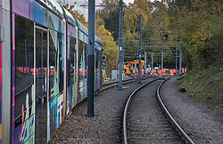 © Licensed to London News Pictures. 13/11/2016. Croydon, UK. A tram (L) sits near Sandilands station as engineers work to restore the line at the site where seven people dies and 50 were injured when a tram rolled over on Wednesday 9th November. Photo credit: Peter Macdiarmid/LNP