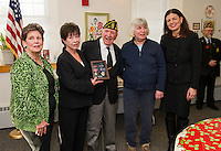 Cadorette's daughters Susan Nolan, Sally Crowell, Rosario Cadorette, Patti Beach and Senator Kelly Ayotte following Pvt 1st Class Cadorette's presentation and honor for his service with two Bronze Stars and a Purple Heart medal Wednesday afternoon with the American Legion Post at the Belmont Mill.  (Karen Bobotas/for the Laconia Daily Sun)