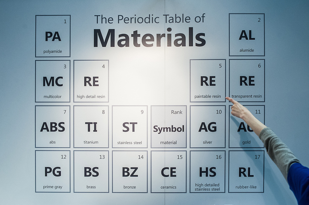 A woman points at a 'Periodic Table of Materials' during the 3D Printshow at the Old Billingsgate in London. 3D Printshow brings together the biggest names in 3D printing technology alongside the most creative, exciting and innovative individuals using additive processes today.