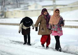 60873940<br /> Afghan girls walk on the snow in Kabul, capital of Afghanistan on December 30, 2013. The first snow of this winter visited the Afghan capital on Monday, 30th December 2013. Picture by imago / i-Images<br /> UK ONLY