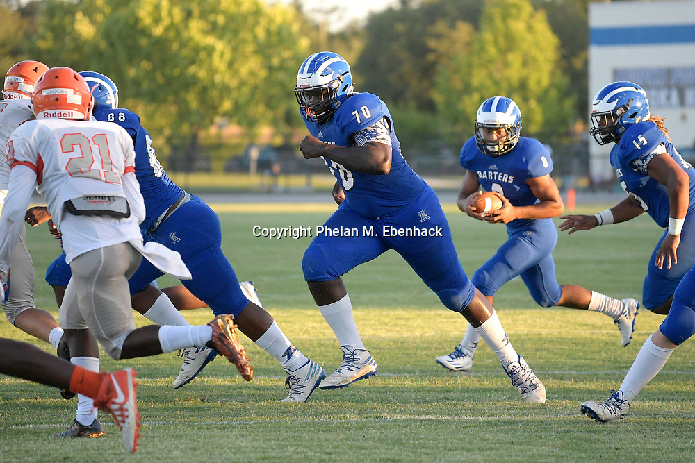 Apopka offensive lineman Ed Montilus (70) prepares to block during the first half of a spring high school football game against Orange City University in Apopka, Fla., Thursday, May 25, 2017. (Photo by Phelan M. Ebenhack)
