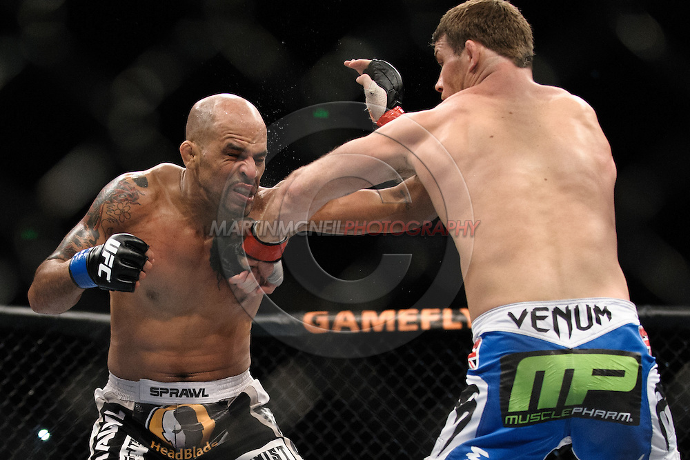 """SYDNEY, AUSTRALIA, FEBRUARY 27, 2011: Jorge Rivera (left) is stunned by a right hook from Michael Bisping during """"UFC 127: Penn vs. Fitch"""" inside Acer Arena in Sydney, Australia on February 27, 2011."""