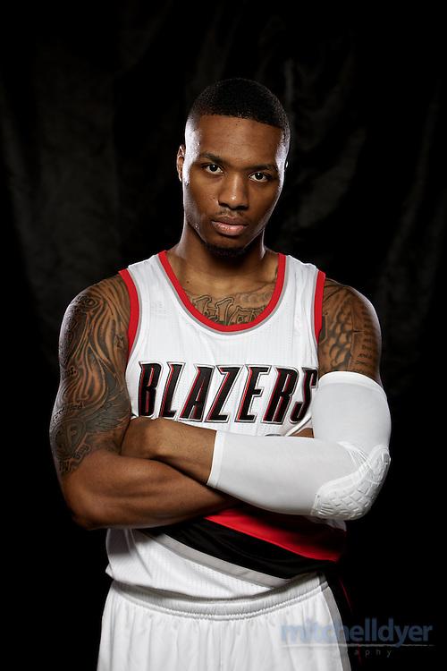 Sep 29, 2014; Portland, OR, USA; Portland Trail Blazers guard Damian Lillard (0) poses during media day at the Moda Center. Mandatory Credit: Craig Mitchelldyer-USA TODAY Sports
