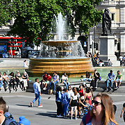 UK Weather - Tourists enjoy the Hottest week in June 2019, in Trafalgar Square, on 27 June 2019, London, UK