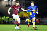 Northampton Town defender Ash Taylor (6) controls under pressure from Shrewsbury Town midfielder Jon Nolan (20) during the EFL Sky Bet League 1 match between Northampton Town and Shrewsbury Town at Sixfields Stadium, Northampton, England on 20 March 2018. Picture by Dennis Goodwin.