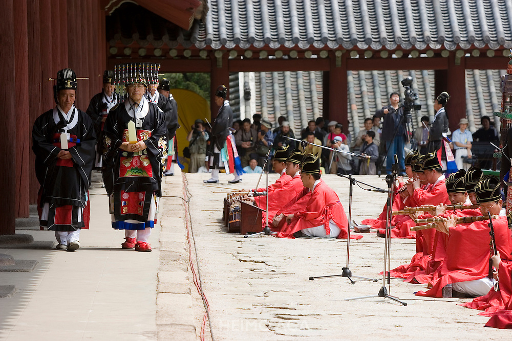 Jongmyo Jerye, a ritual service for Royal ancestors, performed on the first Sunday of May each year. Jongmyo (designated as a World Cultural Heritage by UNESCO in 1995) is a Confucian shrine where the ancestral tablets of kings and queens of the Joseon Dynasty are enshrined. Yi Ki-jon, 71, master of the ceremony (2nd fr. l..), passing the traditional court music called Jongmyo Jeryeak.