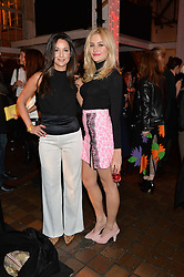 Left to right, ROXIE NAFOUSI and PIXIE LOTT at the YSL Beauty: YSL Loves Your Lips party held at The Boiler House,The Old Truman Brewery, Brick Lane,London on 20th January 2015.