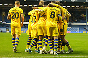 Swansea City players celebrate after Swansea City forward Andre Ayew (22) scores his team's first goal during the EFL Sky Bet Championship match between Sheffield Wednesday and Swansea City at Hillsborough, Sheffield, England on 9 November 2019.