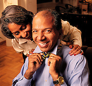 Washington, D.C. mayor Anthony Williams putting on his trademark bowtie with his wife Diane Williams.
