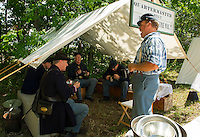 Raymond Peavey takes a little light hearted ribbing on his beef stew cooked over an open fire during 5th NH Volunteer Civil War encampment set up during Sanbornton Old Home Day Saturday.   (Karen Bobotas/for the Concord Monitor)