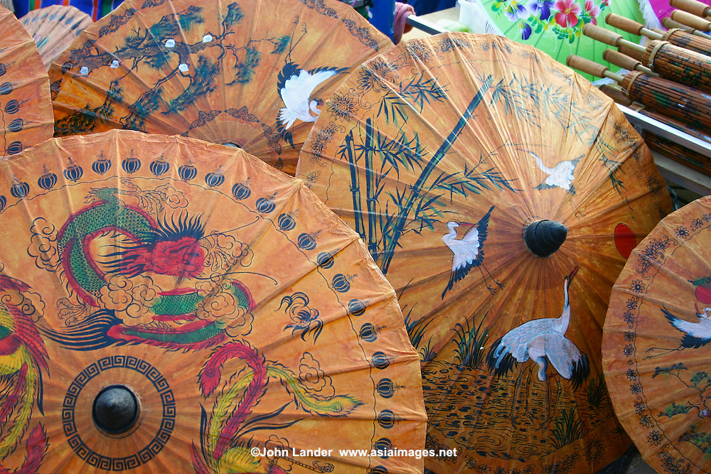 Bo Sang is a village in San Kamphaeng district in the outskirts of Chiang Mai in northern Thailand.  It is known for its hand made umbrellas and parasols which are brightly colored and often decorated with beautiful floral motifs.