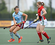 Canterbury's Lucy Barnes challenges with Hamburg's  Charlotte Stapenhorst during their opening game of the EHCC 2017 at Den Bosch HC, The Netherlands, 2nd June 2017