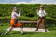 UNITED KINGDOM, London: 25 May 2019 <br /> Cosplayers take pictures outside of the MCM London Comic Con on the first day. Thousands of cosplay enthusiasts will come to the ExCeL Centre this weekend to enjoy the convention.
