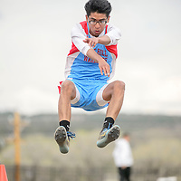 042915  Adron Gardner/Independent<br /> <br /> Pine Hill Warrior Anfernee Begay flies to a first place 19ft 5in jump during the district 1-2A track meet in Ramah Friday.